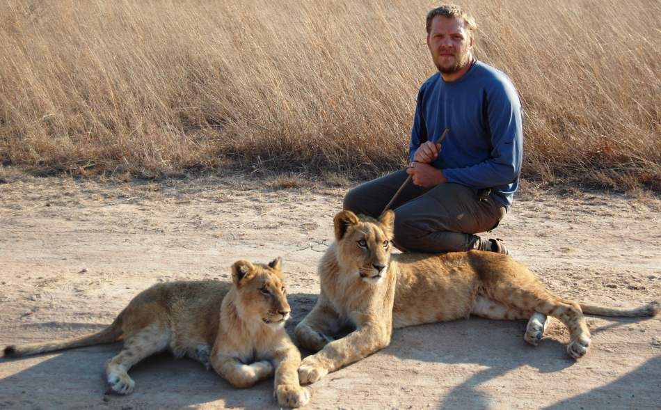 Chris du Preez with lions at The Antelope Park