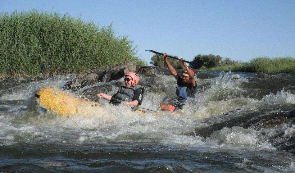 Bouncing through a death defying rapid, with Khamkirri on the Orange River