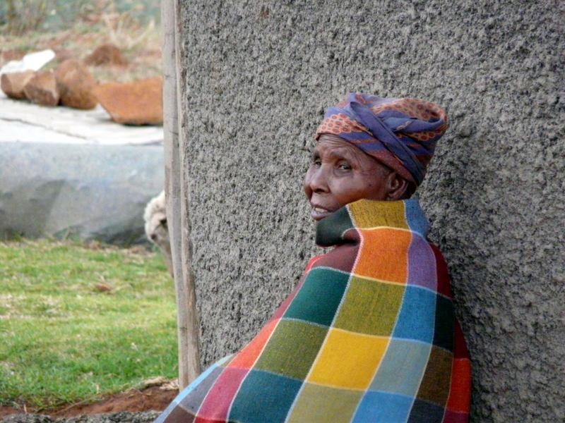 Basotho woman wearing a traditional blanket... it gets cold in the mountains!
