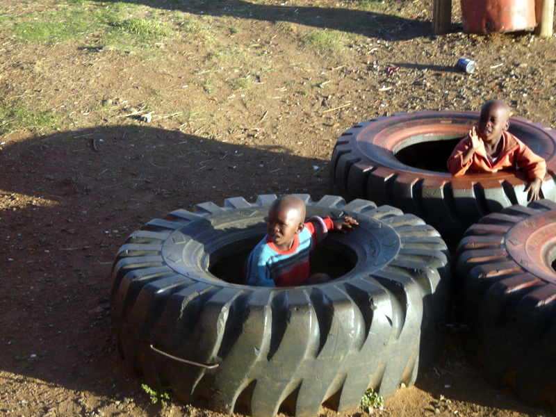 Basotho kids playing in the tractor tyres