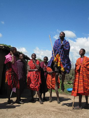 Masai men doing their traditional high jump