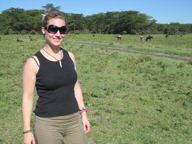 On a nature walk with wildebeest in the background